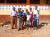 6-SA-pupils.-Behind-Hamida-is-the-school-education-adviser-member-of-the-board-a-retired-teacher-from-a-teacher-trainee-college-native-of-Asiakwa