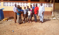 6-SA-kids-with-F-H.-head-teacher-in-Red-Tee-shirt.-Behind-Hamida-is-a-member-of-school-board