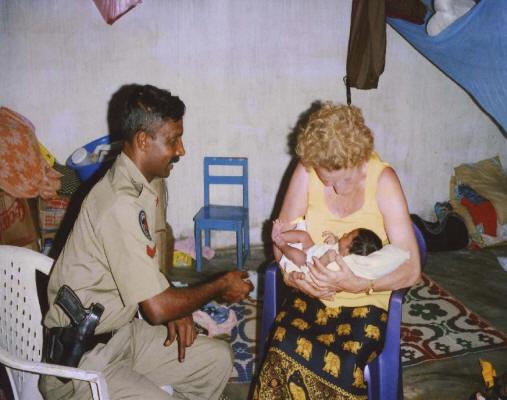 Jenny cradling \'miracle\' Tsunami baby