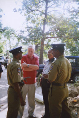 Stuart and Jogy discuss the situation with our police escort