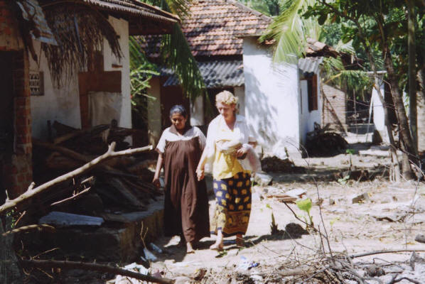 Jenny inspects this lady\'s devastated home